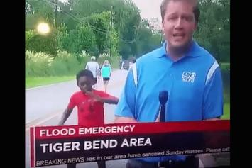 Little Kid Dances Hilariously Behind Reporter in Baton Rouge, Louisiana