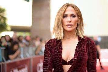 Jennifer Lopez's Versace Boots Had Everybody Thinking Her Pants Fell Off