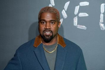 Kanye West Steals A Versace Earring From Fashion Show