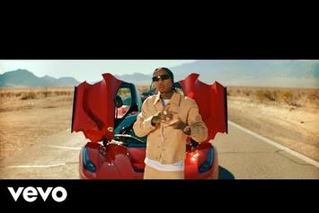 "Tyga Flexes In The Desert With Dozens Of Ferraris For ""Floss In The Bank"""
