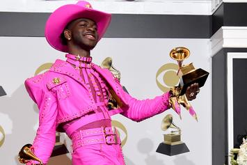 Lil Nas Takes A Victory Drink From One Of His Grammy Awards
