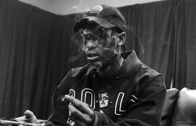 Travis Scott smoking backstage