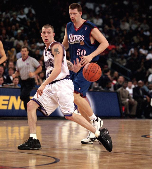 Jason Williams #55 of the Sacremento Kings passes the ball behind his back during the NBA Allstar Weekend Rookie Game at the Oakland Coliseum in Oakland, California.
