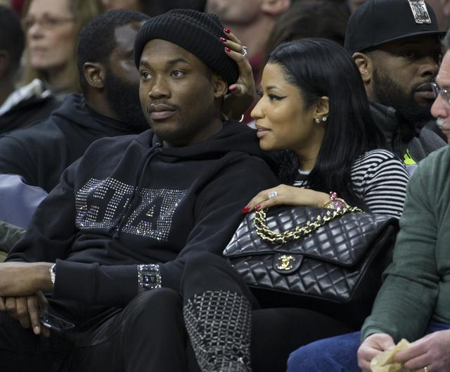 Nicki Minaj and Meek Mill sitting courtside at a basketball game together
