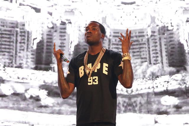 Meek Mill throws his hands up