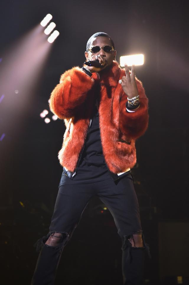 Fabolous rocking fur while performing at TIDAL show