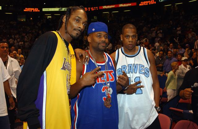 Jay-Z, Dame Dash and Snoop Dogg posing together at basketball game 2002