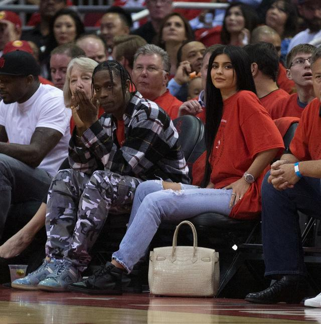 Travis Scott & Kylie Jenner at basketball game together