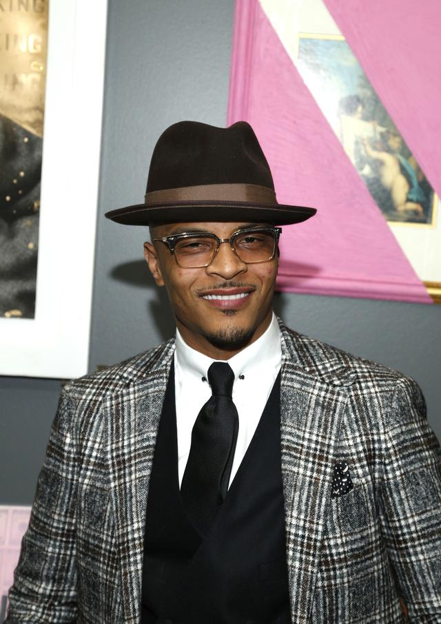 T.I. suited up