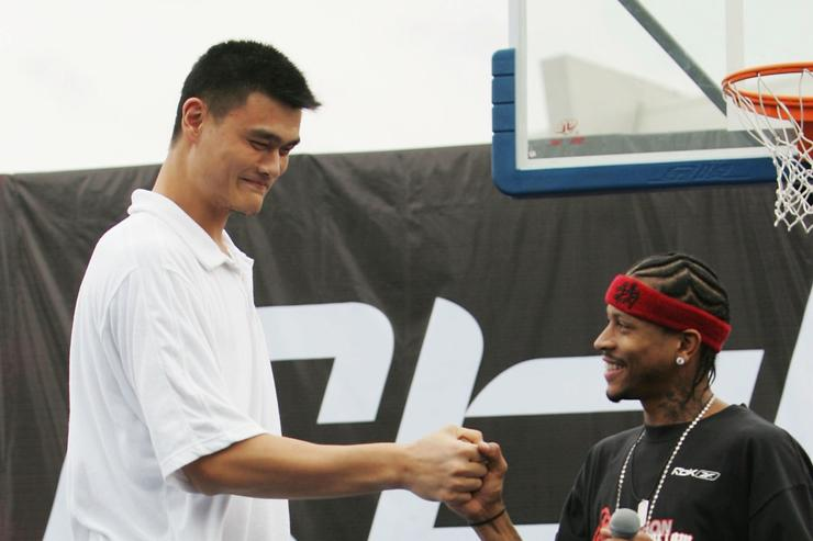 NBA star Allen Iverson (R) of USA and Yao Ming of China shake hands during an event at Shanghai Stadium on September 25, 2005 in Shanghai, China. Philadelphia 76ers guard Allen Iverson is visiting Shanghai as the last leg of his Asia Tour