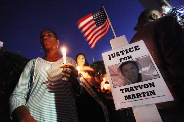 Supporters gather during a candelight vigil at a memorial to Trayvon Martin outside The Retreat at Twin Lakes community where Trayvon was shot and killed by George Michael Zimmerman while on neighborhood watch patrol on March 25, 2012 in Sanford, Florida. Participants planted a cross at the site to honor Martin.