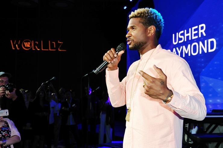 Usher speaking on stage
